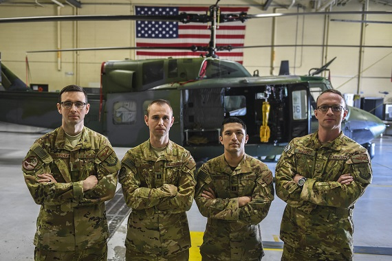 Team Minot aircrew search-and-rescue team members stand in front of a UH-1N Iroquois at Minot Air Force Base, N.D., April 5, 2018. Members of the 54th Helicopter Squadron at Minot Air Force Base responded to a search and rescue call involving a man trapped in his cabin, surrounded by rising flood water, in Savage, Montana